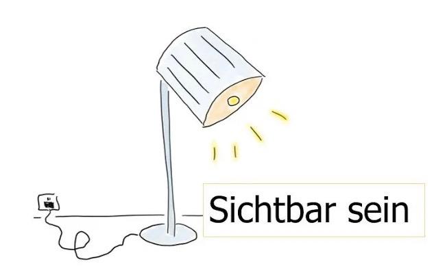 Zeichnung einer leuchtenden Stehlampe. Unter der Stehlampe steht: sichtbar sein