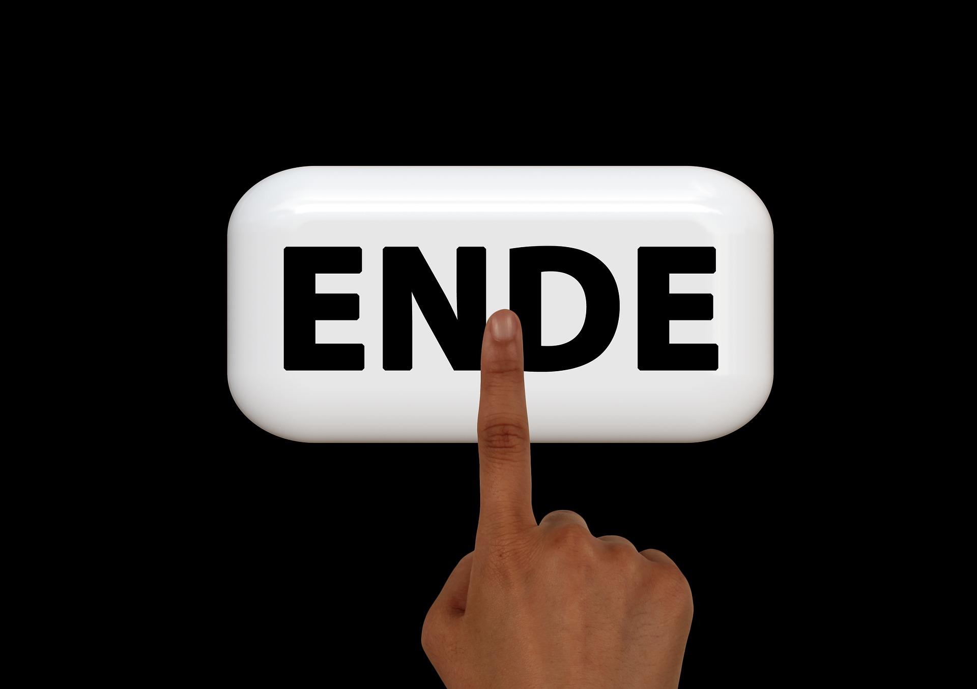 Symbolbild: Ein Zeigefinger einer Hand zeigt auf ein Feld: Auf dem Feld steht: Ende